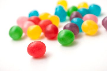 closeup of colorful round candies on white background