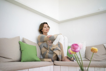 Relaxed mature woman sitting on bench