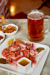 Beer snack in the pub or bar. Beer, shrimps and nuts.