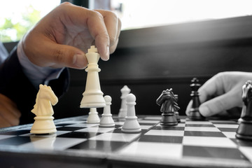 Businessman play chess use King Chess Piece white to crash overthrow