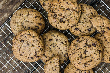 A Heap of Freshly Baked Chocolate Cookies on Cooling Rack. Sweet Biscuits. Homemade pastry. Overhead View.