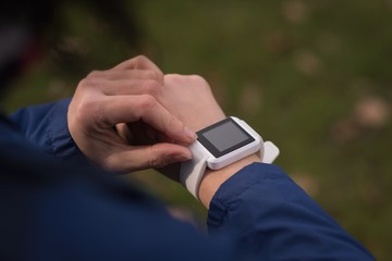Woman using smartwatch in the park
