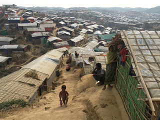 A boy climbs up a steep hillside in Chakmakul camp for Rohingya refugees in southern Bangladesh