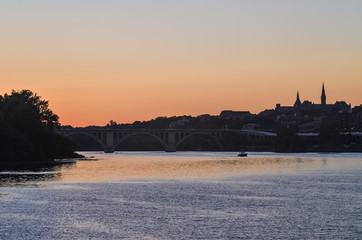 Potomac river with skyline of Georgetown during sunset