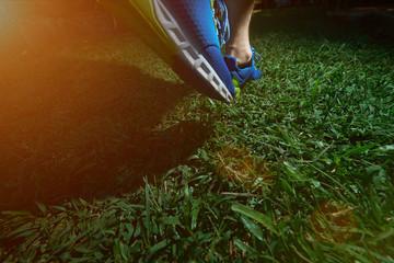 Man jogging on green field grass