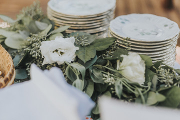 Flower Garland and Stacked Vintage China Dishes
