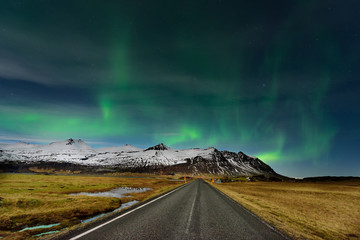 The Northern Light at the mountain in Iceland. Landscape with green bands of Aurora Borealis. Nightscape magical.