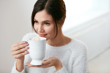 Drink. Woman Drinking Hot Drink