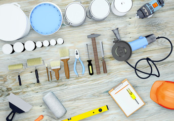 Set of tools and paints for making repair on wooden background.