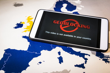 Smartphone with Geo-blocking over EU map. European Union Digital single market and regulation against Geo-blocking and geographically-based restrictions