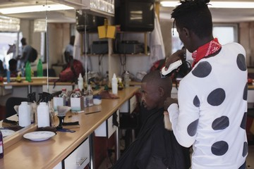 Barber shaving mans head