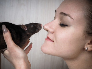 Amazing portrait - the girl's face and muzzle rats closeup