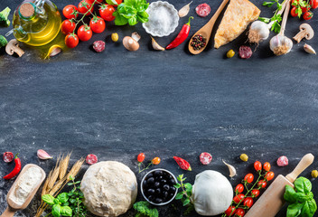 Tuinposter Pizzeria Pizza Ingredients On Black Table In A Raw - Italian Food