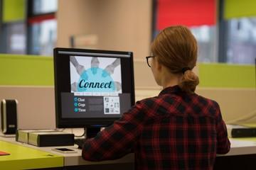 Young woman using a desktop pc