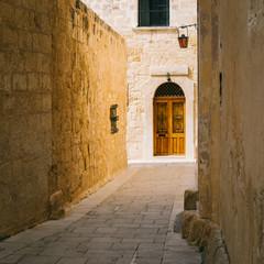 Narrow street of ancient Silent City, Mdina, Malta