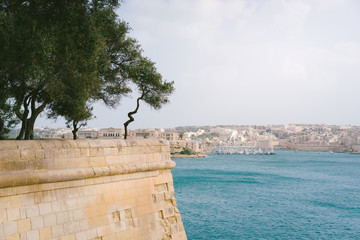 The Grand Harbour view from city walls of Valletta at sunny spring day. Malta Island