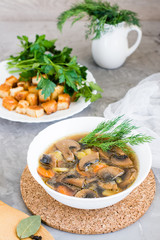 Homemade mushroom soup with champignons, fresh herbs and breadcrumbs