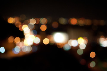 Close up Blurred Defocused bright multicolored yellow green red city lights in bokeh effect