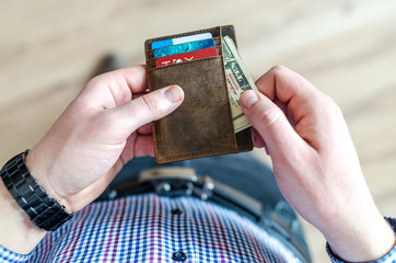Man holding leather wallet