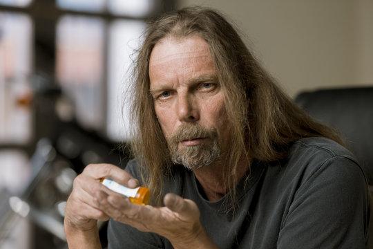 Man with an Opiod Prescription Pill Bottle