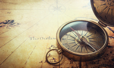 Fototapete - Magnetic compass on world map.Travel, geography, navigation, tourism and exploration concept background. Macro photo.
