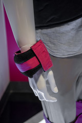 White mannequin model wearing pink adjustable training weight bag