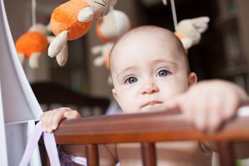 Little girl in her crib