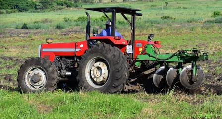 A Heavy Duty Tractor. It Is Ploughing Using A Harrow Discs Plough