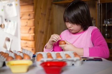 Easter holiday. Girl painting and decorating Easter eggs.