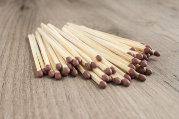 A pile of wooden safety long match sticks on wooden background