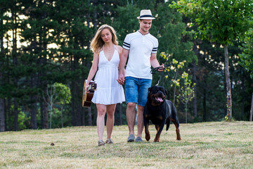 Couple with dog in nature