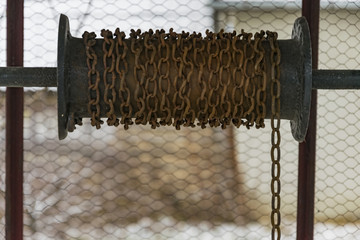 This is a chain on a metal drum