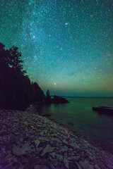 Milky way and starry sky along the lakeshore of Georgian Bay at night