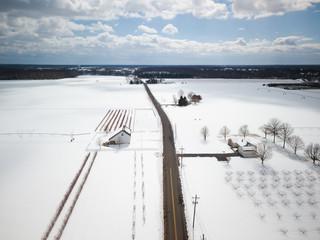 Aerial of Snow covered farmland
