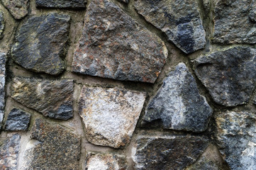 Old weathered stone wall texture .Part of a stone wall, for background or texture