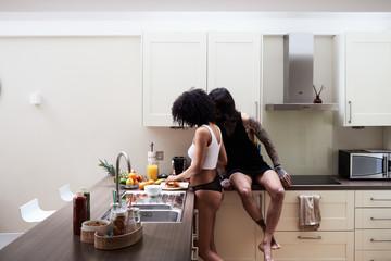 Man looking at cooking girlfriend
