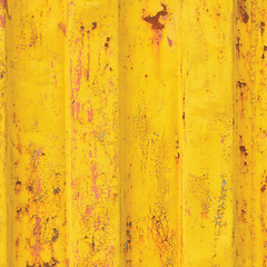 Yellow sea freight container background rusty corrugated pattern, vertical rusted detailed steel texture cracked grungy metal paint detail, old aged weathered textured rust grunge copy space closeup