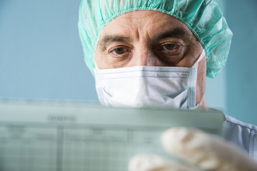 Close-up of Surgeon looking at Medical Chart