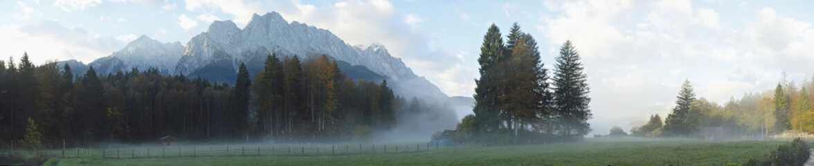 Landscape of highest mountain in Germany (Zugspitze) in the distance, on an early morning in autumn, view from Tirol, Austria