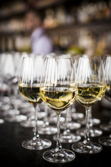 Glasses of white wine kept on bar counter at wedding reception