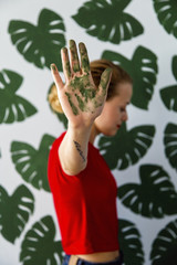 Woman gesturing with dyed hand
