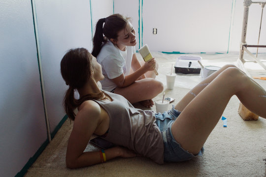 teenagers being funny while taking a lunch break during painting