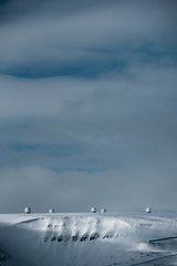 Radar domes on a snow covered mountain