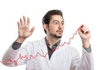 A man in a white coat drawing a positive chart on a clear transparent glass