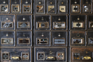 Wall of old post office boxes in Barkerville Historic Town in British Columbia, Canada