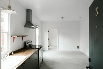 modern empty home with concrete floors