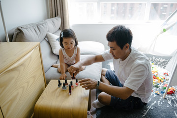 Adorable daughter painting father nails