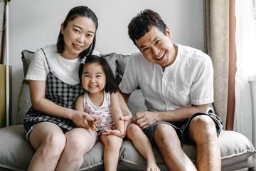 Portrait of a young Chinese family