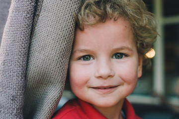 Portrait of a cute curly blond kid