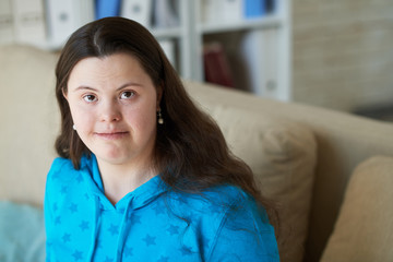 Smiling young woman with Down syndrome